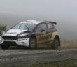 Pioggia e nebbia della prima tappa non rallentano Evans