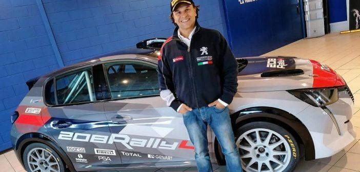 Paolo Andreucci al fianco della nuova 208 Rally4 alla presentazione Milanese.